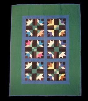 Amish quilt, Cat's Paw design circa 1930-1940.  63in x 49in.  Harvey Art and Antiques