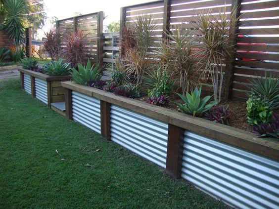 Low corrugated iron & wood retaining wall. Would look great in an Australian bush garden.