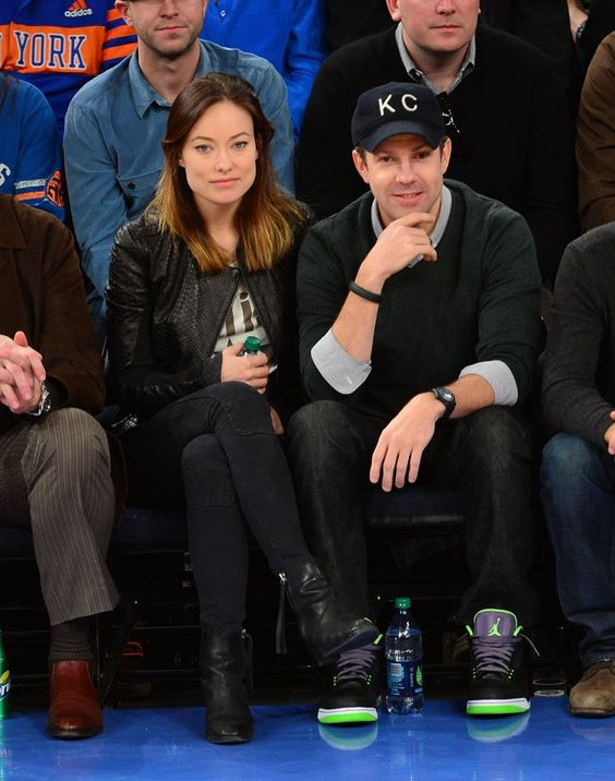 Pin for Later: The REAL Reason We're Loving Basketball?  Olivia Wilde chose a rocker-cool leather jacket and quilted ankle boots for a February 2013 Knicks game with fiancé Jason Sudeikis.