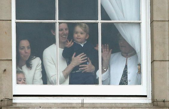 Prince George Photos - Trooping The Colour - Zimbio Prince George of Cambridge is held by his nanny Maria Teresa Turrion Borrallo as he waves from the window of Buckingham Palace as he watches the Trooping Tthe Colour on June 13, 2015 in London, England. The ceremony is Queen Elizabeth II's annual birthday parade and dates back to the time of Charles II in the 17th Century, when the Colours of a regiment were used as a rallying point in battle.
