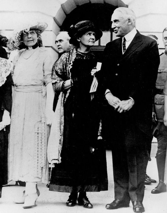 PRESIDENT WARREN G. HARDING and FIRST LADY FLORENCE HARDING honoring MARIE CURIE at the White House.  Guests joined one another outside -- taking a break from the East Room ceremony -- by request from the photographers who noted there wasn't enough light in the East Room. -- May 20, 1921