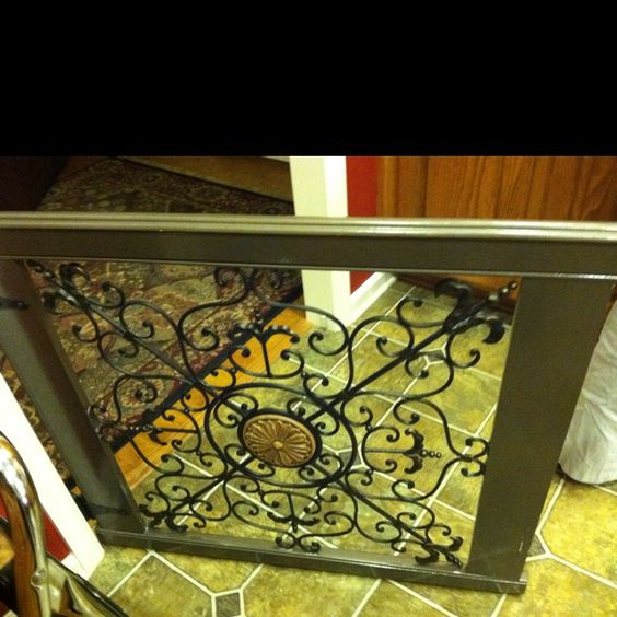 A friend of mine made this baby/dog gate using a purchased iron wall hanging