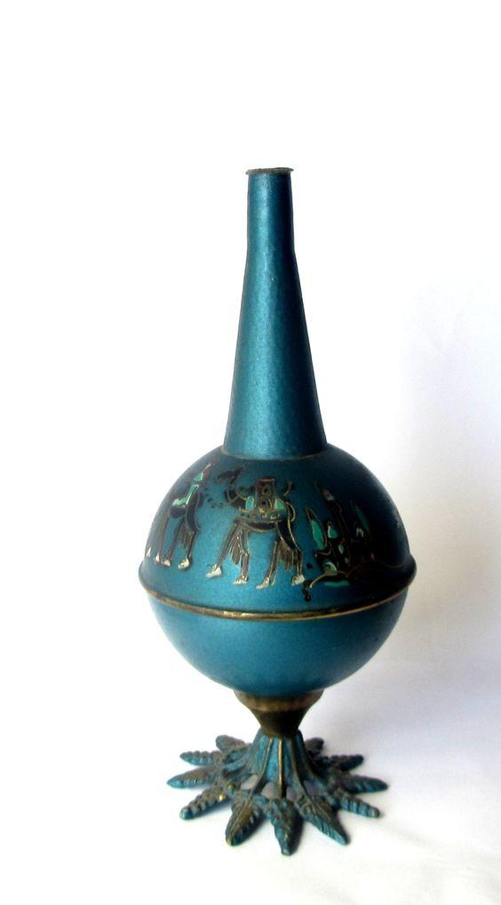 https://www.etsy.com/il-en/listing/225296122/vintage-unique-blue-small-copper-vase?ref=shop_home_active_1