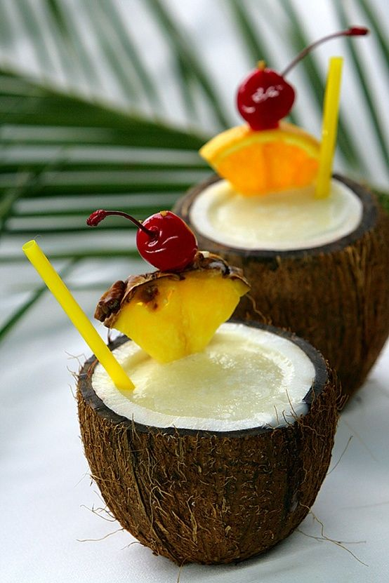 Pina Colada    Ingredients    1/2 cup of ice  2 parts Rum (Light)  2 tbsp Cream of Coconut  1/2 cup pineapple chunks  1-2 tbsp vanilla ice cream  Pineapple slice and cherry for garnish    * Mini-umbrellas (once again, they're awesome!)  * Also you can serve in a coconut for a tropical feel.