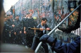 The Berlin wall being torn down.