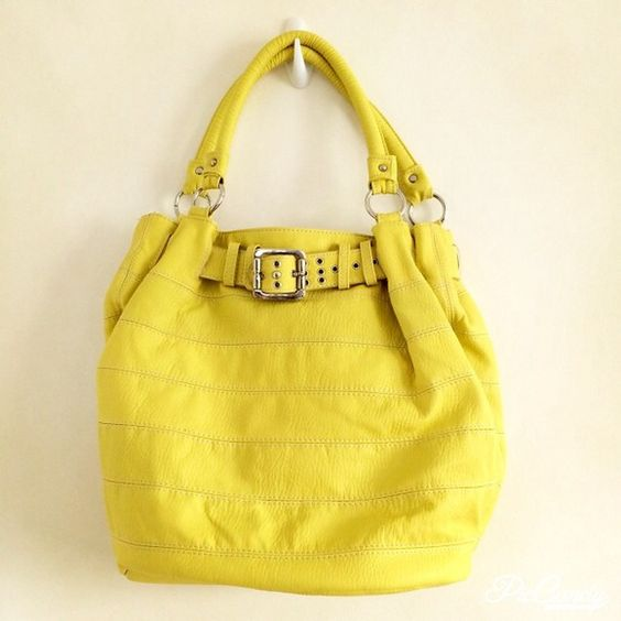 """❄️BIG BRIGHT YELLOW BUCKET HANDBAG This is a great bag to carry everything. Its a pretty bright yellow. A bag that will add a pop of color to any outfit. It's made out of fake leather, inside it's lines with this white nylon lining. It's been used probably a handful of times . But looks like new. Not spots, dirt, tears or wear signs. It has multiple pockets inside . Two with zippers. Magnetic closure for bag. With 2 handles than can go over shoulder. Width 17"""" Height  14"""" ( not including…"""
