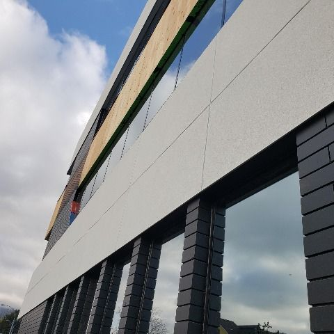 Stoquik Silver System On Commerce Centre In Kelowna Bc A Decorative High Impact Cement Board Stucco System Combines The St In 2020 Exterior Installation Drainage