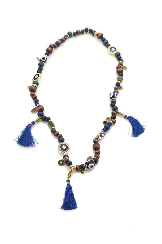 Evil eye charm, wood and glass African beads, and blue tassels with metal spacers. By Hendrikka Waage. #Icelandic #Fashion #Style #Lastashop