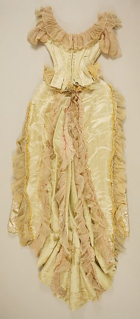 Ball gown (back view) Design House: House of Worth Designer: Charles Frederick Worth Date: ca. 1887 Culture: French Medium: silk, glass, metallic thread Accession Number: 49.3.28a, b