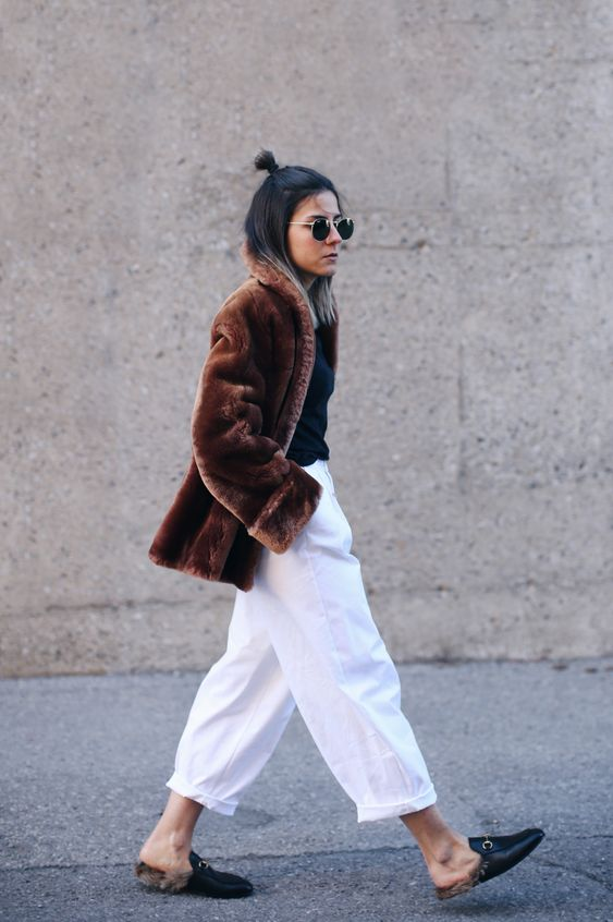 white trousers + gucci slides + round sunglasses: