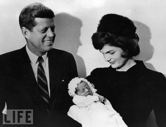 U.S. president-elect John F. Kennedy and his wife Jacqueline smile at their son's christening on Dec. 10, 1960. The boy was born on Nov. 25, 1960, just 16 days after JFK won the presidential election.