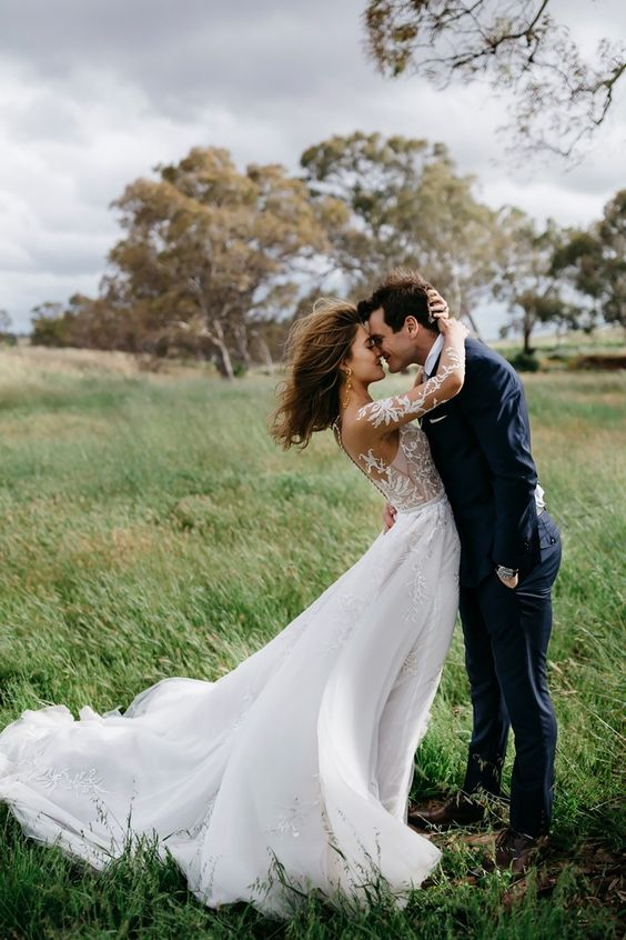 We can't get enough of these windswept wedding photos | Photo by Katie Harmsworth: