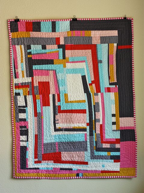 Wonderfully wonky quilt with strips of various widths and heights running vertically and horizonally - Gee's Bend influence: