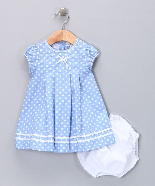 Cute! This picnic-perfect frock features a pretty polka dot print and classic pleated design. A matching diaper cover completes the charming look. Includes dress and diaper cover100% cottonHand wash; hang dryImported