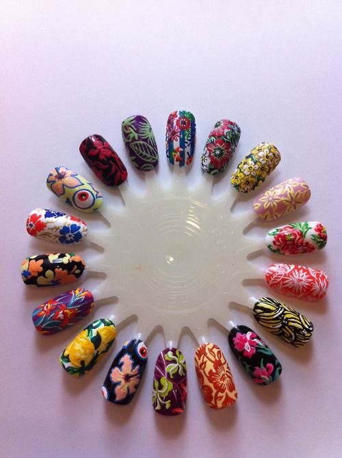 tSome nail designs inspired by Floral Prints from the Spring/Summer 2011 catwalk! Floral prints are gonna be HUGE this season! My favourite is the Giles hibiscus flower and eyeball print, so COOL!!!  Miss Hawaii!!!