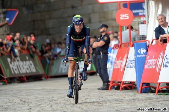 2014 vuelta-a-espana photos stage-21 - Adriano Malori (Movistar) crosses the (dry) finish line Santiago de Compostela. 1st 9.7 km in 11:12