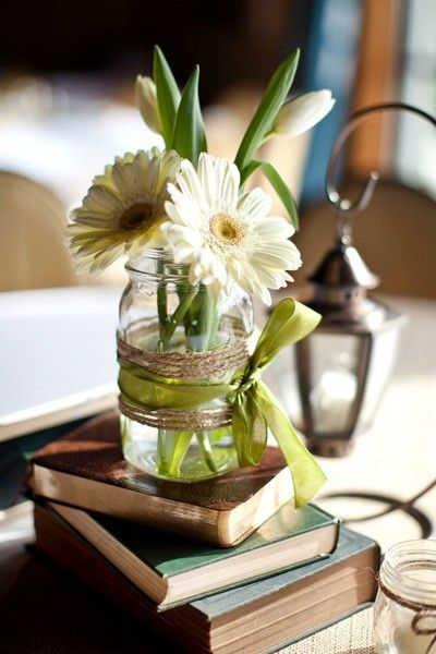 A simple way to bring a few flowers from the yard in now and then...Vintage ribbon wrapped canning jar, a few old books