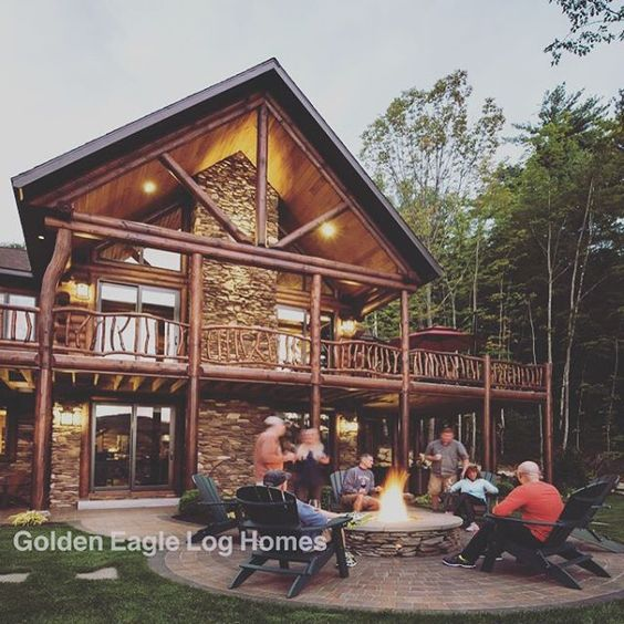 Log home living in front of the impressive Modified North Carolina. Photos and floor plans of this custom home are at www.GoldenEagleLogHomes.com #loghomes #logcabins #loghome #logcabin #outdoors #wood #nature #GoldenEagleLogHomes #GELHNorthCarolina