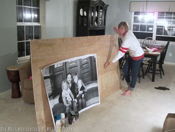 "Love this idea! Will do with new family pics! Staples does oversized prints called ""engineer prints."" The largest size is 3' x 4'. Guess what - they only cost $4.99!!"