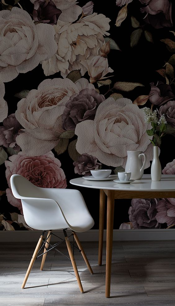 Create a dramatic backdrop to candlelit dinners with this dark floral wallpaper. Sumptuous tones of deep purple and pink combine to give a strikingly beautiful design. Perfect for dining and living room spaces.: