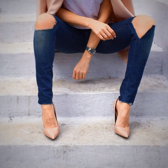 Ripped blue jeans and nude heels