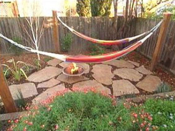 We could put pillars like this around the patio and use for hammocks or strings of lights during the night or when hammocks aren't being used. Or even do the trellis idea on a couple of them for permanent vines and lights. We could also use tension rod and outdoor curtains for removable shade/privacy blinds when hammock is down.