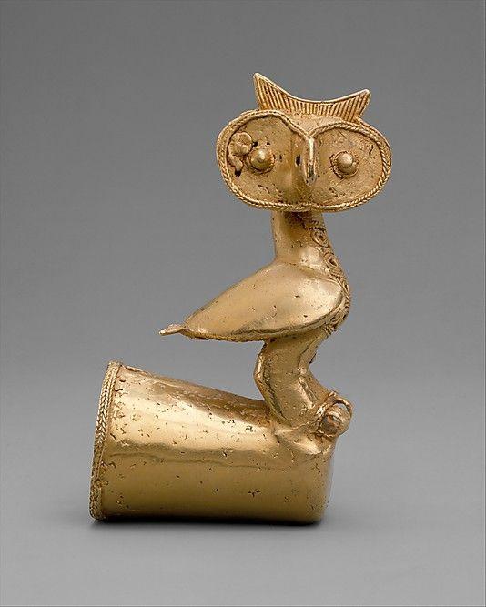 Owl Finial    Date:      5th–10th century  Geography:      Colombia  Culture:      Zenu or Sinu  Medium:      Gold  Dimensions:      H. 4 3/4 x W. 2 5/8 x D. 1 3/4 in. (12.1 x 6.7 x 4.5 cm)  Classification:      Metal-Ornaments