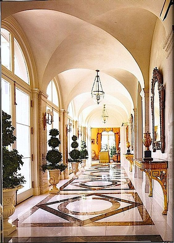 Interior by Alexa Hampton.  I love the floor design and the topiaries!