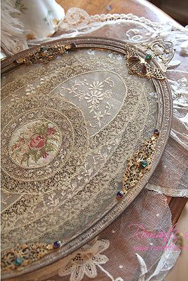 Make a pretty vanity tray or wall art from old picture frame or tray, paint and line with pretty laces or elegant doilies