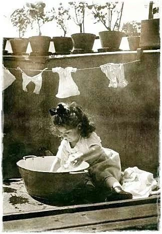 Vintage Photo: little girl washing her dolls clothes in a tin bath so sweet! http://stores.ebay.com/NYC-Discount-Diva: