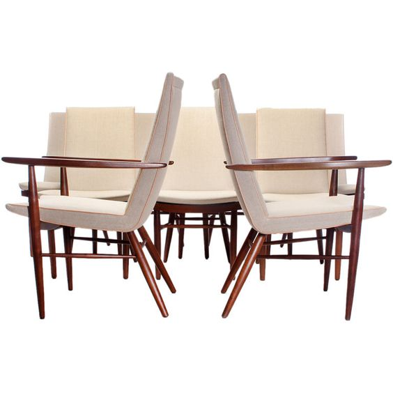 George Nakashima; Walnut Dining Chairs for Widdicomb, 1950s.