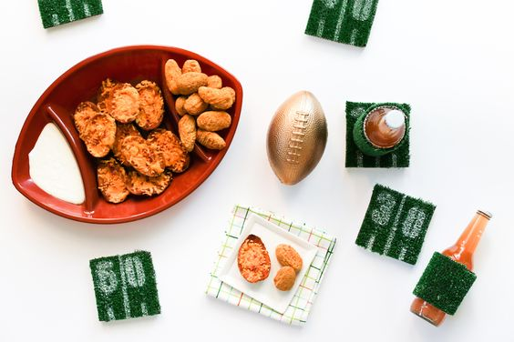 Protect your coffee table with DIY Football Astroturf Yard Line Coasters.