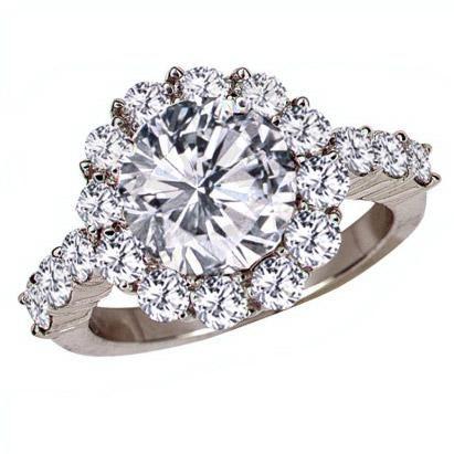 "Platinum ""shared prong"" semi-mount for round diamond from Gumuchian."