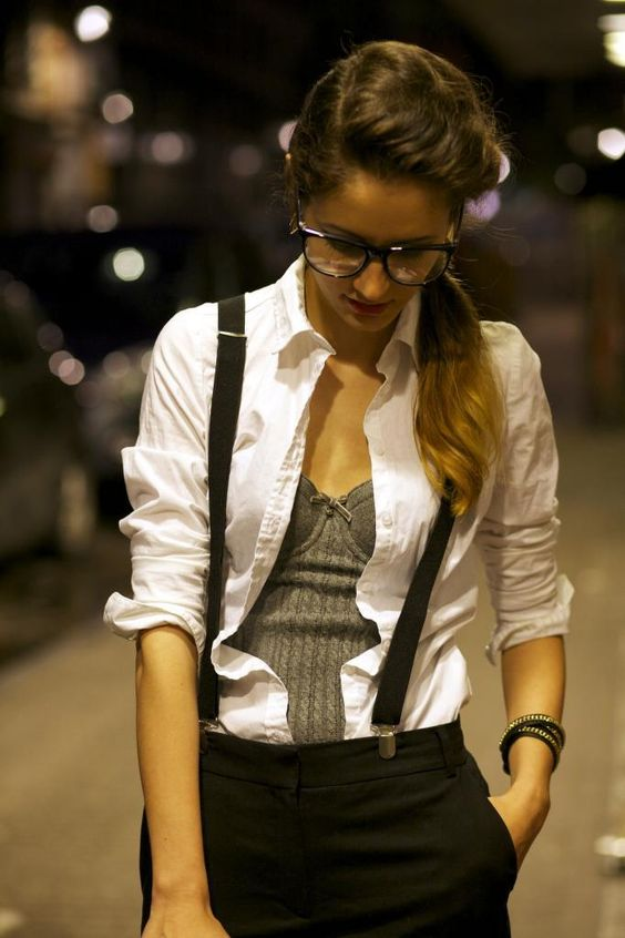 White dress shirt, gray camisole, black shorts, and suspenders.