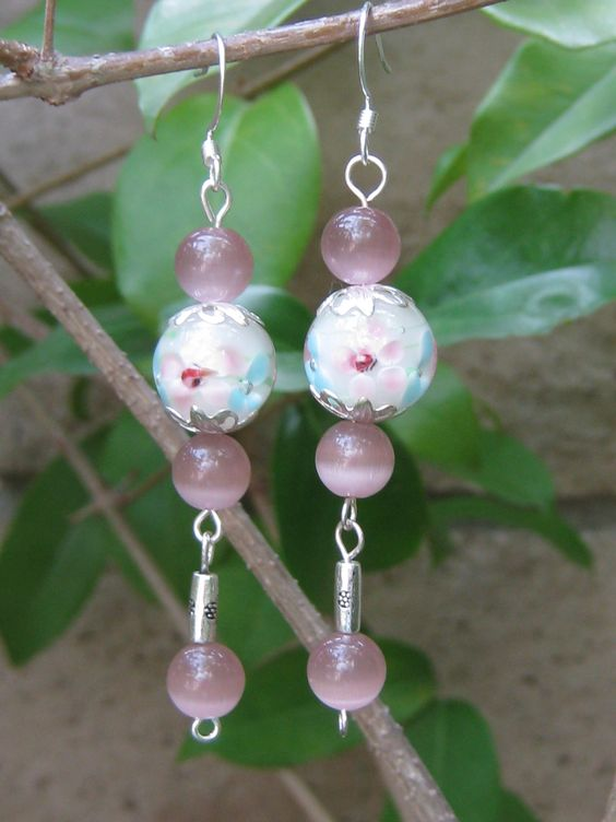 Earrings-White floral lamp work beads-Shy violet cats eye beads-Sterling silver tube beads. $11  www.etsy.com/shop/jewelsbywendy