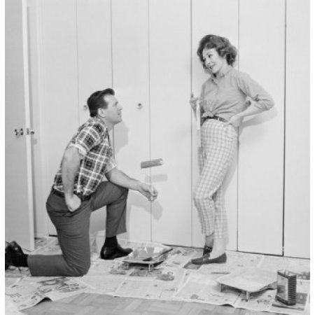 House husband painting closet door while housewife is watching Canvas Art - (18 x 24)