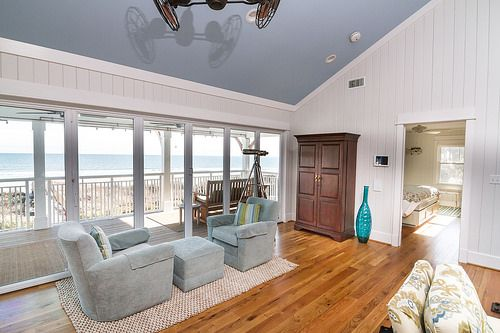 So many things to love in this room - the hardwood, the fan, the view!  CRG Companies www.crgconstruction.com