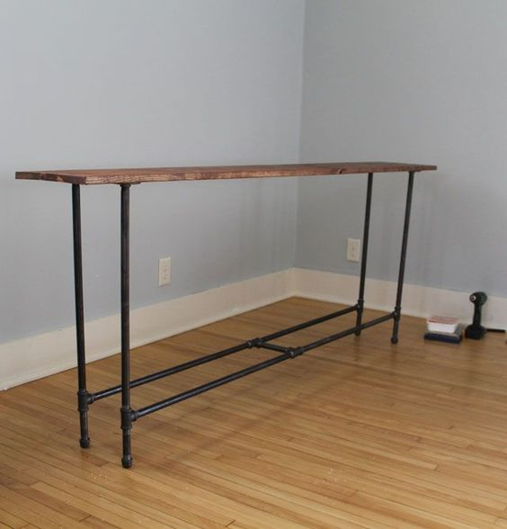 DIY industrial pipe console table on Mr. and Mr. Blandings, excellent behind a couch, and who knew you could find everything in a local hardware store.
