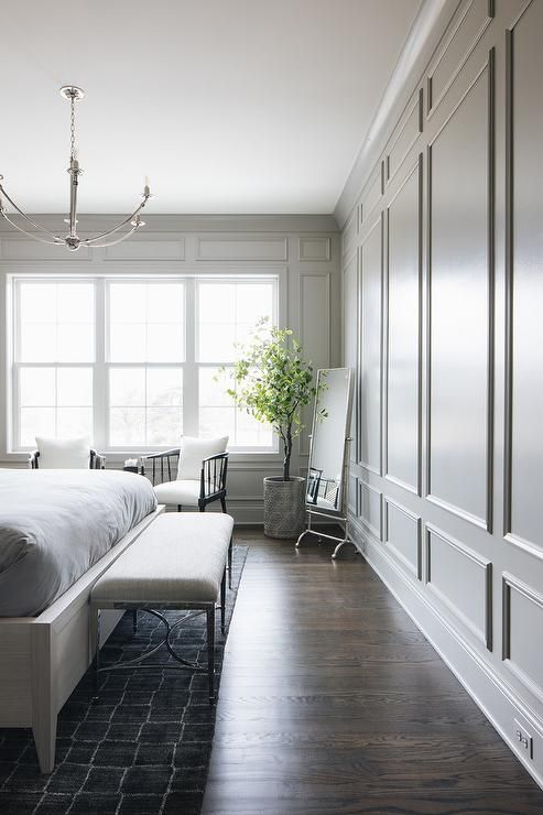 Floor To Ceiling Gray Wainscoting Covers The Walls Of This Gorgeous Bedroom Featuring A Vintage Floor Mir Interior Design Simple Bedroom Luxury Interior Design