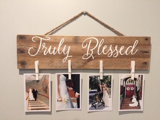 A beautiful pallet picture holder uses reclaimed palled wood and white clothes pins to display memories of your loved ones. This pallet sign picture frame measures approximately 5x18 and comes with a rustic twine rope to hang right on your wall. This farmhouse style clothes pin picture display reads Truly Blessed across the top but this pallet art is definitely customizable!  Message me if you would like your family name or a different saying across the top of your picture holder! This pallet...: