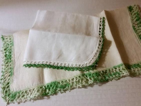 Vintage handkerchiefs with green and white lace trims. One hankie has tatted lace. One hankie has crocheted lace. Two are offered as one group. Both hankies are in very good condition. The color tone of the linen centers is white on one and a cre...