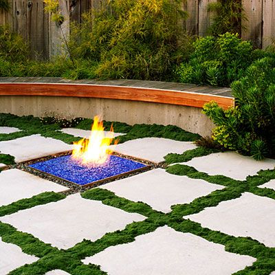 "Grid: 'Elfin' thyme turns this patio into a giant checkerboard. Growing in 4-inch-wide strips dividing poured-in-place concrete squares, it's irrigated by a subsurface drip system and needs only the occasional light pruning. Sea thrift  keeps the grid     from looking too controlled. (That blue ""gravel"" in the firepit is recycled glass.)  Design: Jeffrey Gordon Smith Landscape Architecture"