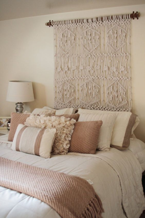Use a macrame wall hanging as headboard so creative and
