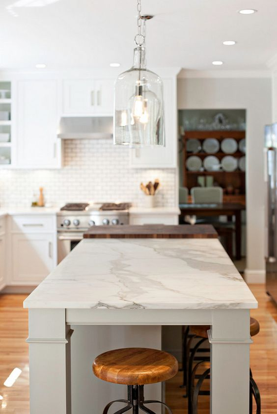 A nice island can create the ideal look (and versatility) for your kitchen. This one combines the calacatta with butcher's block to create a more useful accent.