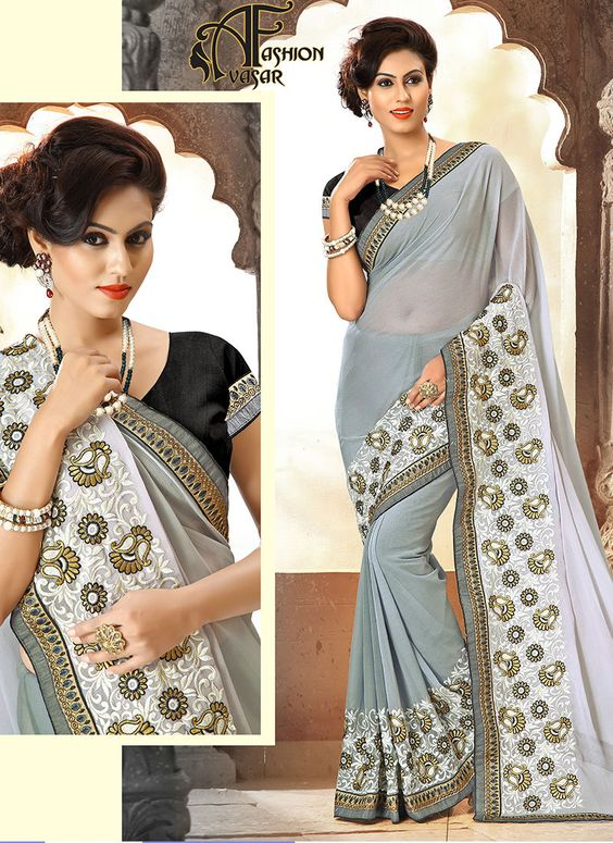 gray embroidered semi chiffon saree.Be the sunshine of every person's eyes dressed with this appealing Slate Gray Chiffon Saree. The ethnic Lace & Crystals