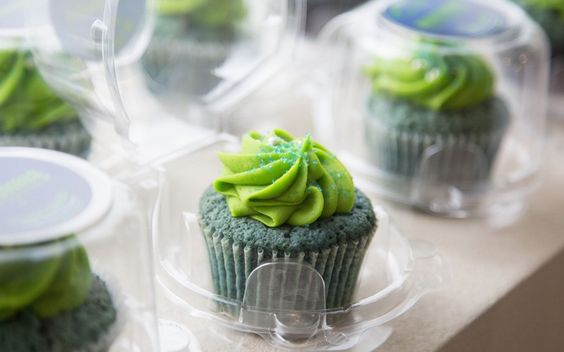 Seattle Seahawks-themed marijuana cupcakes are displayed at the Queen Anne Cannabis Club in Seattle, Washington. For Nate Johnson, the excitement surrounding the forthcoming Super Bowl is two-fold. Not only are his hometown Seattle Seahawks taking on the Denver Broncos - football teams representing two major U.S. cities where recreational pot use is legal - but his medical weed dispensary is seeing green.