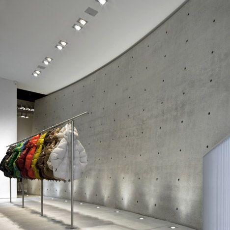 Tadao Ando divides Duvetica store with curved concrete wall