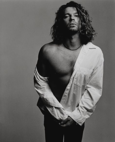22nd Nov 1997, INXS singer Michael Hutchence was found dead in his hotel suite in Sydney. He was 37. Hutchence body was found at 11.50am naked behind the door to his room. He had apparently hanged himself with his own belt and the buckle broke away and his body was found kneeling on the floor and facing the door. It had been suggested that his death resulted from an act of auto eroticism, no forensic or other evidence to substantiate that suggestion was found.