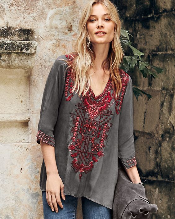 Four shades of red add depth and detail to the intricately embroidered paisley and geometric shapes of this tunic. Created by Johnny Was, the company renowned for exceptional embroidery and carefree style.: