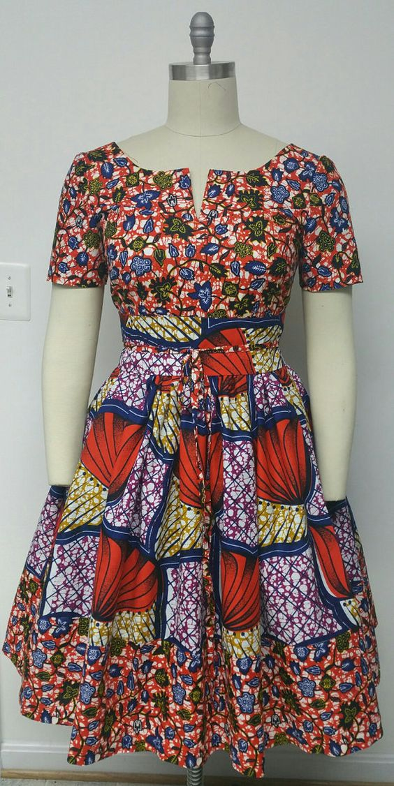 African Print Fitted Waist Dress. Mid-Low back. Inside Pockets. Obi Sash. Womens Clothing. Handmade Clothing. Womens Dresses. This is a fully lined multi fabric fitted waistline dress with attached petticoat and an Obi Sash..      INCLUDED:  • One dress and One Obi Sash    DETAILS:  • African Print.  • Care Instructions: Dry Clean Only. (affiliate)